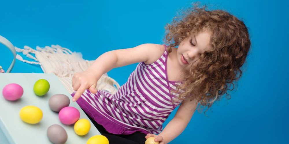 Child,Engaged,In,An,Easter,Activity